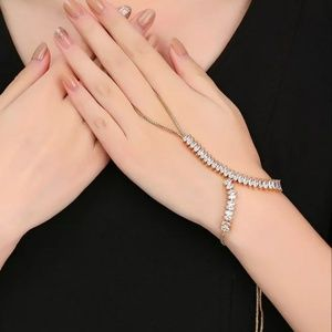 Ring with bracelet